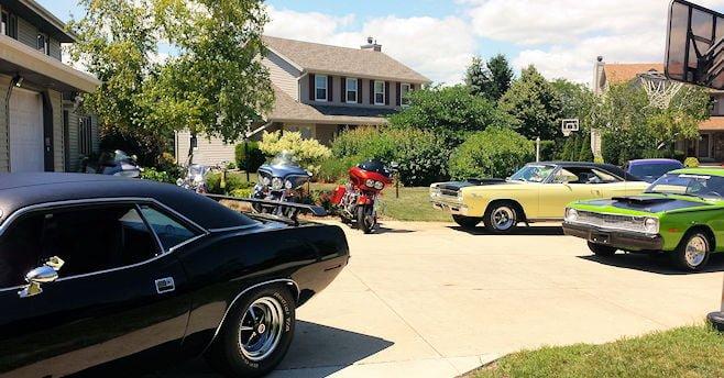 A driveway full of classic cars