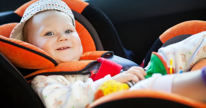 Baby in child safety seat